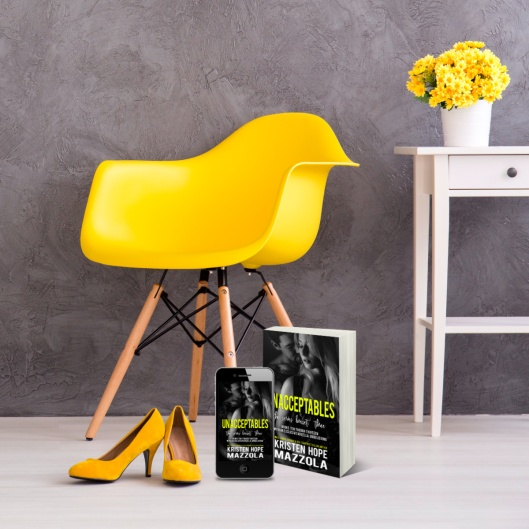 Shot of a grey modern room with yellow decorations